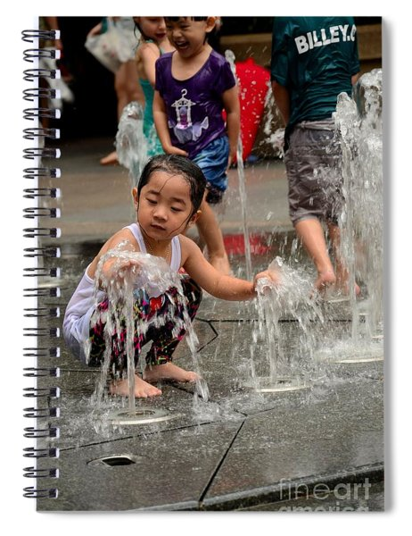 Clothed Children Play At Water Fountain Spiral Notebook