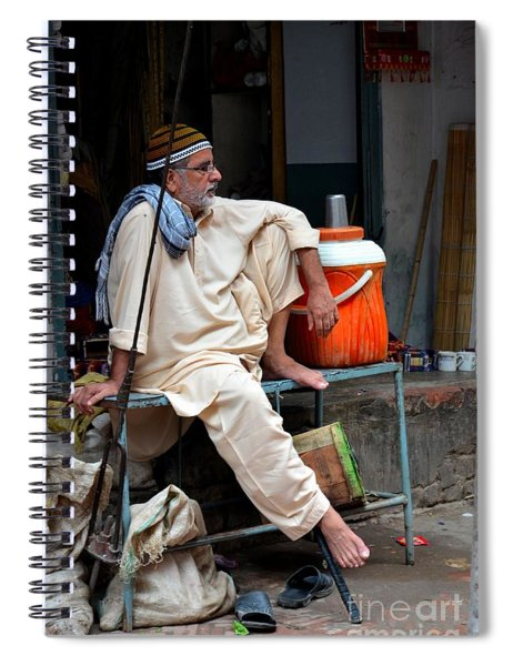 Man Sits And Relaxes In Lahore Walled City Pakistan Spiral Notebook