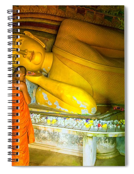praying buddhist monk by a lying buddha in Sri Lanka Spiral Notebook