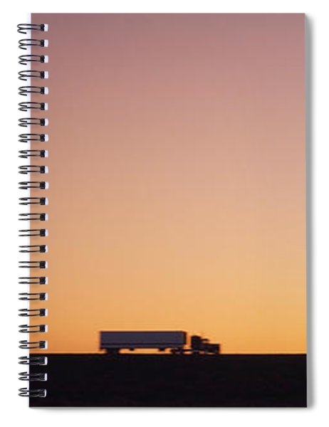 Silhouette Of Two Trucks Moving Spiral Notebook
