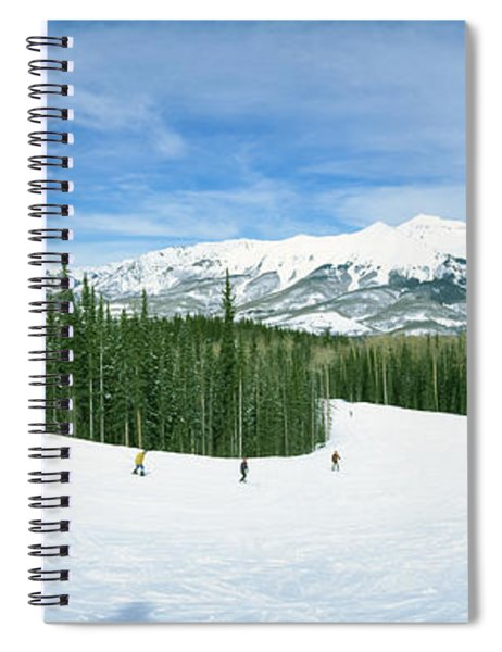 Tourists Skiing On A Snow Covered Spiral Notebook