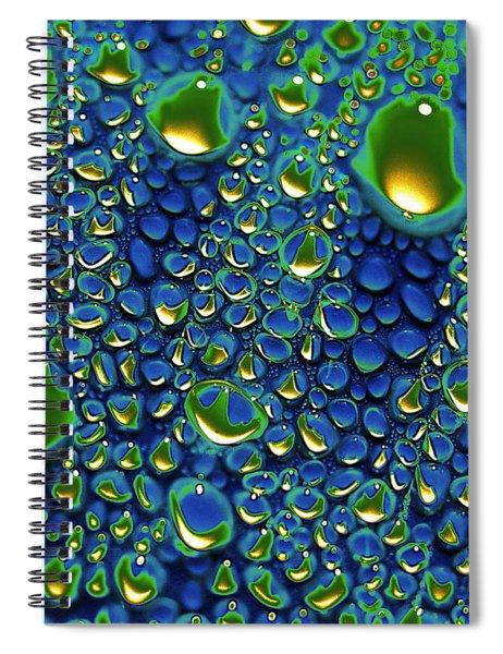 Wax Holds Up Spiral Notebook