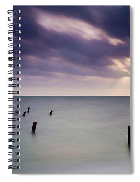 Wooden Posts In Sea Under Stormy Sky Spiral Notebook
