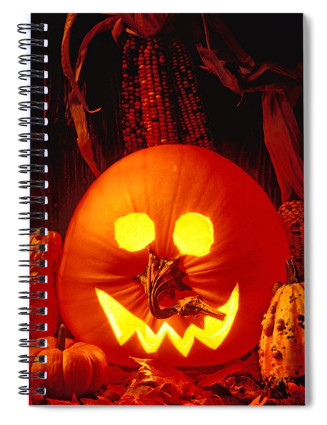 Carved Pumpkin With Fall Leaves Spiral Notebook by Garry Gay