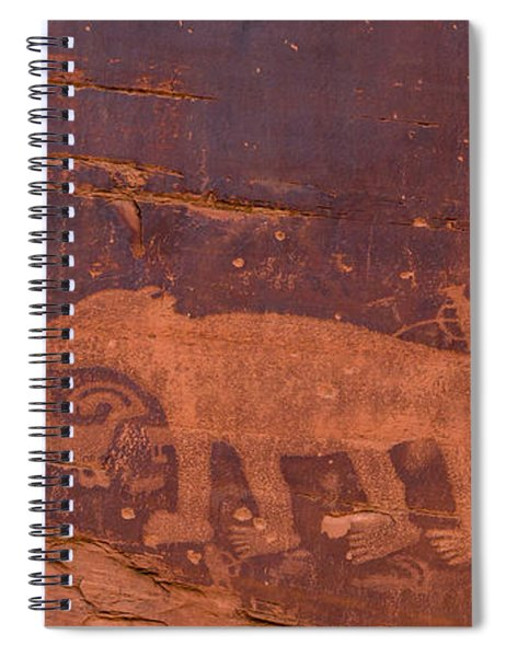 Spiral Notebook featuring the photograph Ancient Native American Petroglyphs On A Canyon Wall Near Moab. by Jim Thompson