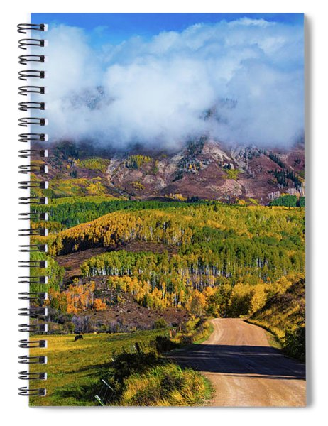Spiral Notebook featuring the photograph The Road To The Elk Mountains by John De Bord