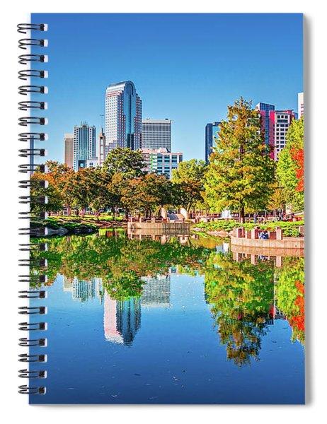 Charlotte City Skyline From Marshall Park Autumn Season With Blu Spiral Notebook by Alex Grichenko