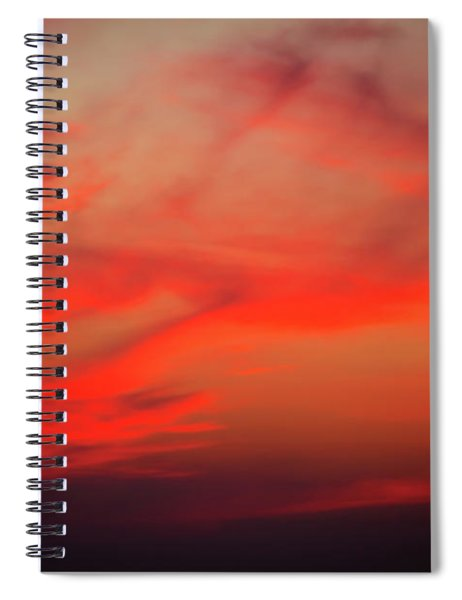 a gorgeous sunset with luminous red clouds over the Yala Nationalpark Spiral Notebook