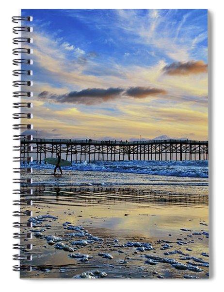 A Surfer Heads Home Under A Cloudy Sunset At Crystal Pier Spiral Notebook