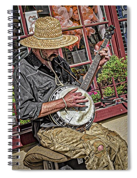 Spiral Notebook featuring the photograph Banjo Man Orange by Jim Thompson
