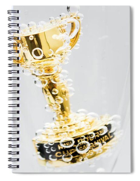 Closeup Of Small Trophy In Champagne Flute. Gold Colored Award I Spiral Notebook