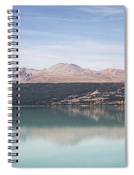 he turquoise water of lake Pukaki in New Zealand Spiral Notebook
