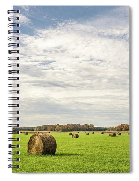 Large, Round, Bales Of Hay Under A Blue Sky With Clouds Spiral Notebook