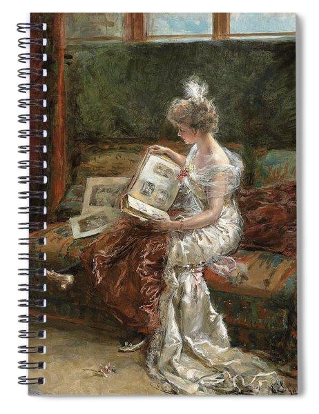 Leonie Garrido Looking At An Album Of Prints Spiral Notebook