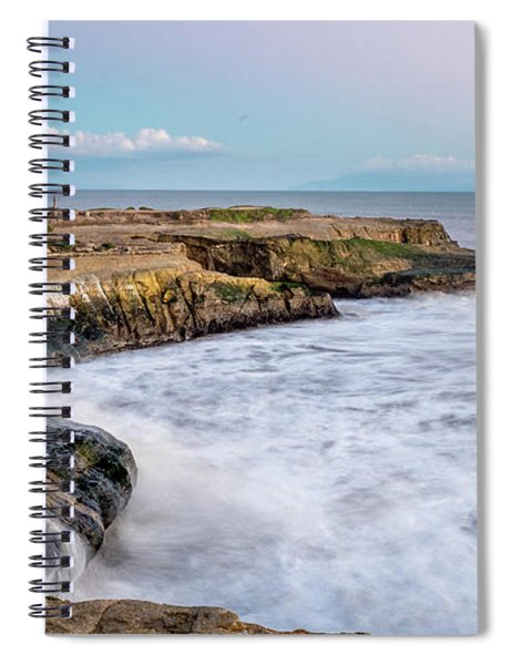 Long Exposure Of Waves Against The Cliff With Lighthouse In Shot Spiral Notebook
