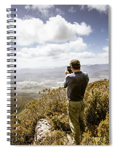 Male Tourist Taking Photo On Mountain Top Spiral Notebook
