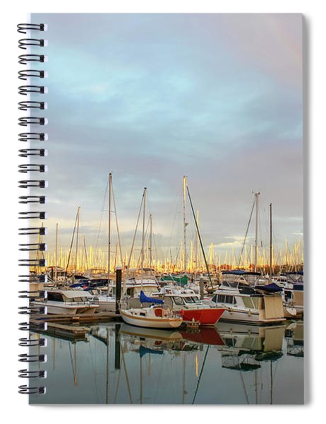 Marina At The Golden Hour With Sunshine Highlighting The Masts Of The Sailboats And A Rainbow In The Spiral Notebook
