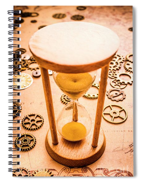 Old Hourglass Near Clock Gears On Old Map Spiral Notebook
