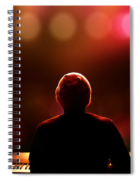 Pianist On Stage From Behind Spiral Notebook