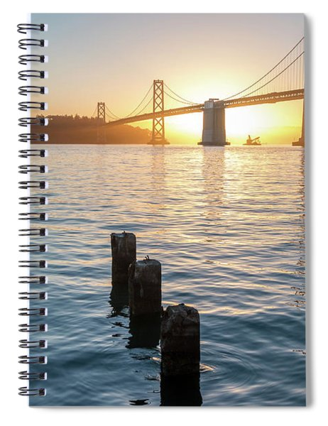 Six Pillars Sticking Out The Water With Bay Bridge In The Backgr Spiral Notebook