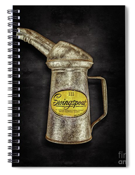 Swingspout Oil Can On Black Spiral Notebook