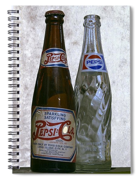 Two Pepsi Bottles On A Table Spiral Notebook