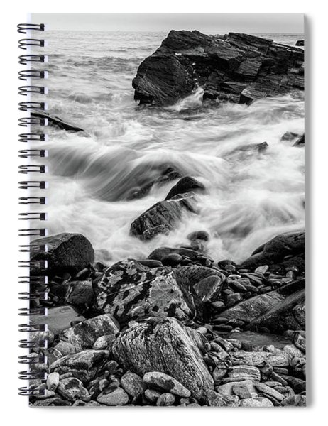 Spiral Notebook featuring the photograph Waves Against A Rocky Shore In Bw by Doug Camara