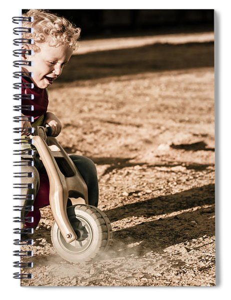 Young Boy Breaking At Fast Pace On Toy Bike Spiral Notebook