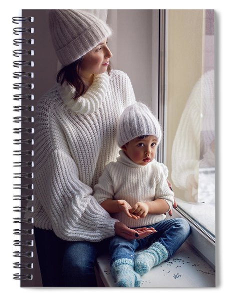 Mom And Son In White Knitted Sweaters And Hats Sitting On The Window Spiral Notebook