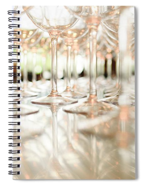 Group Of Empty Transparent Glasses Ready For A Party In A Bar. Spiral Notebook