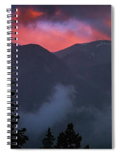 Sunset Storms Over The Rockies Spiral Notebook by John De Bord