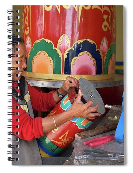 Tibetan Woman Repairing Prayer Wheels In Mcleod Ganj Spiral Notebook