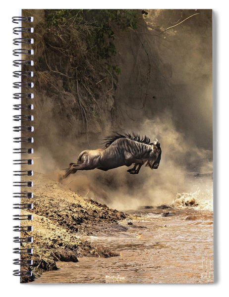 Wildebeest Leaps From The Bank Of The Mara River Spiral Notebook