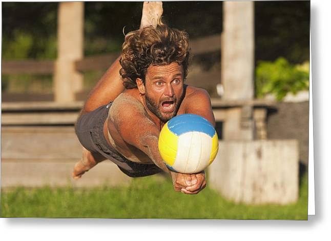 A Man Diving For A Beach Ball Tarifa Greeting Card