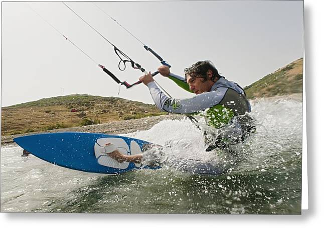 A Man Kite Surfing Off The Coast Of Greeting Card by Ben Welsh