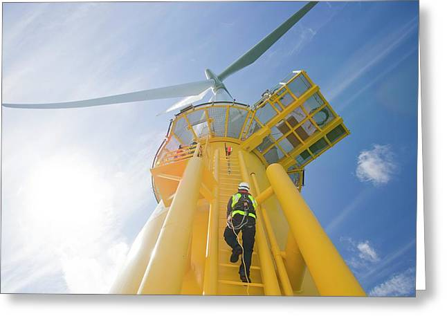 A Worker Climbs A Turbine Greeting Card by Ashley Cooper