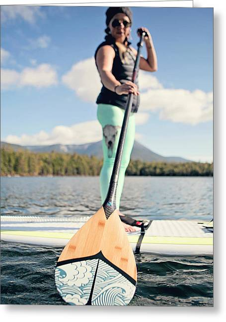 A Young Woman Paddles Boards On Daicy Greeting Card