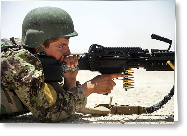 An Afghan National Army Soldier Fires Greeting Card