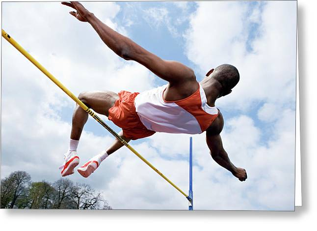 Athlete Performing A High Jump Greeting Card by Gustoimages/science Photo Library