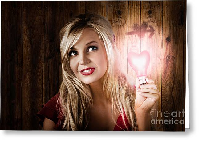Attractive Young Blond Girl Holding Love Light Greeting Card
