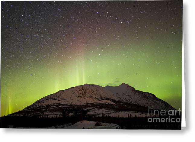 Aurora Borealis And Milky Way Greeting Card by Joseph Bradley