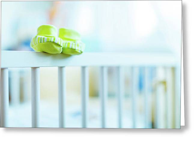 Baby Shoes On The Edge Of A Cot Greeting Card