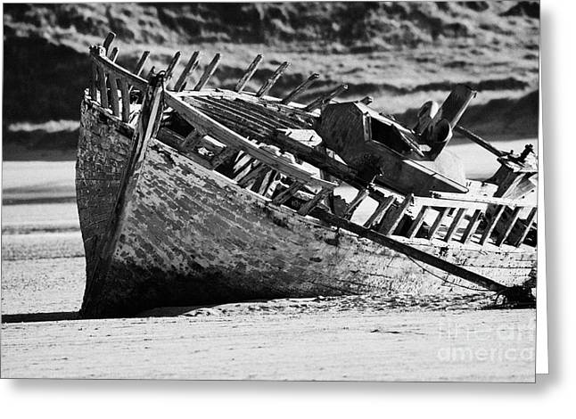 boat wreck on bunbeg beach in gweedore gaeltacht county Donegal Republic of Ireland Greeting Card