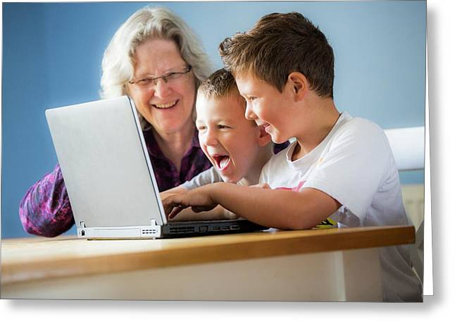 Boys Using Laptop With Grandmother Greeting Card