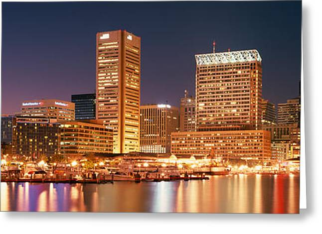 Buildings Lit Up At Dusk, Baltimore Greeting Card by Panoramic Images