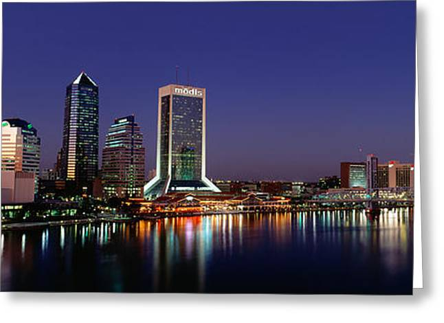 Buildings Lit Up At Night Greeting Card by Panoramic Images