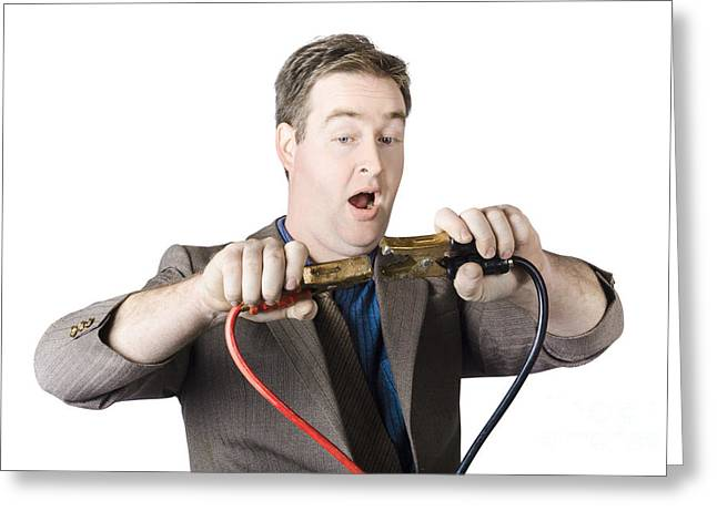 Businessman About To Connect Jumper Cable Greeting Card by Jorgo Photography - Wall Art Gallery