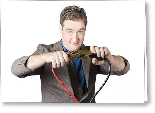 Businessman Holding Jumper Cables Greeting Card by Jorgo Photography - Wall Art Gallery