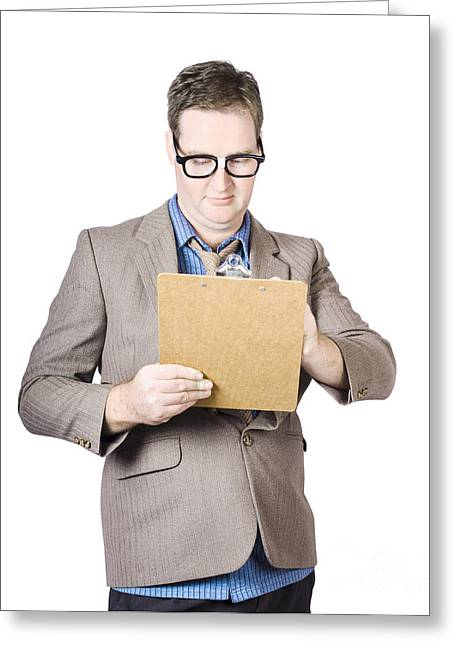 Businessman Looking At Clipboard Greeting Card by Jorgo Photography - Wall Art Gallery