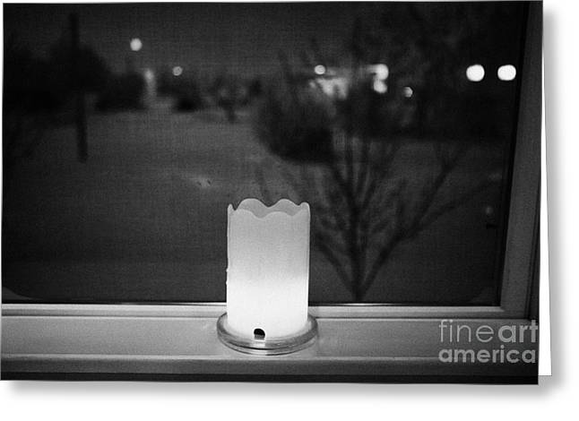 candle in the window looking out over snow covered scene in small rural village of Forget Saskatchew Greeting Card by Joe Fox
